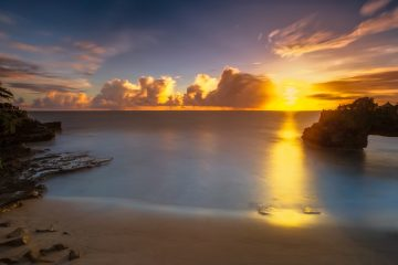 experience the magical sunset in tanah lot